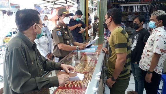 Satpol PP Kelurahan Kelapadua Sosialisasi Jam oprasional Baru Bagi Pelaku Usaha Mikro