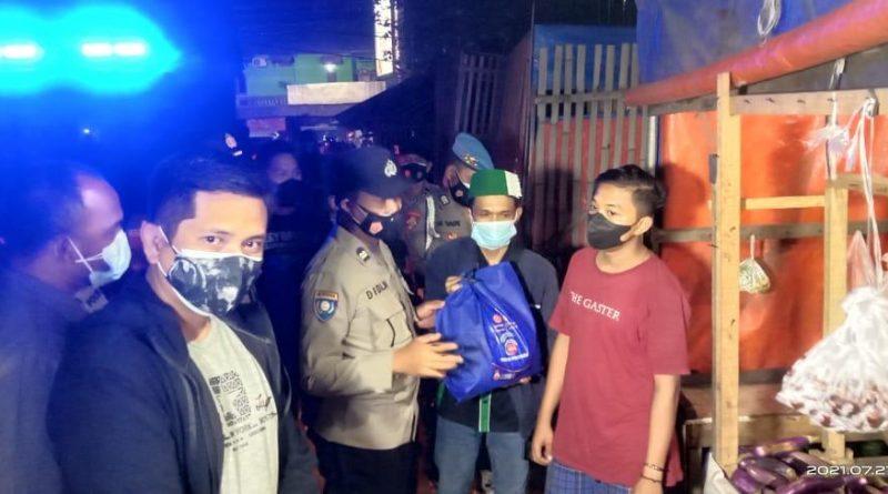 Gelorakan Potmas, Polresta Tangerang Ajak HMI Distribusikan Bantuan Sosial dan Masker ke Masyarakat
